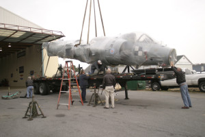Crew works with crane to lift the FA-2 Sea Harrier aircraft off the trailer. Georgetown, DE. 2006