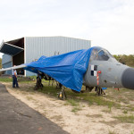 After arriving at Capt. W.F. Dure Regional Airport in Leonardtown, MD, the Sea Harrier is removed from the shipping trailer and the wing is partly attached.  2006