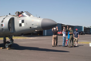 "With Art Nalls in the cockpit of his FA2 Sea Harrier, the engine is successfully started for the first time in the US. As the engine shuts down, the work crew breaks into a series of hugging and ""high fives."" Leonardtown, MD 2006"