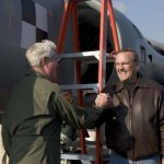 Art Nalls returns his FA2 Sea Harrier to its hanger as well- wishers surround him following his successful first flight in the aircraft.    Meanwhile, his ground crew secures the aircraft. St. Mary's County airport.  Nov 10 2007  Leonardtown, MD   2007